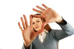 Hand`s frame. The girl looks through a framework from hands Stock Photos