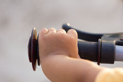 Hand's little girl and bicycle handlebar Royalty Free Stock Photography