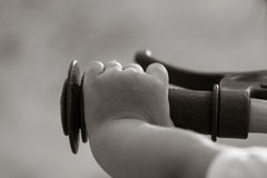 Hand's little girl and bicycle handlebar, black and white style Stock Image