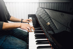 Hand`s man playing piano. With light Royalty Free Stock Photography