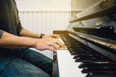 Hand`s man playing piano. With light Royalty Free Stock Image