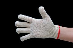 Hand in safety glove. Isolated on black Stock Photo