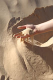 Hand in Sahara sand Royalty Free Stock Photography