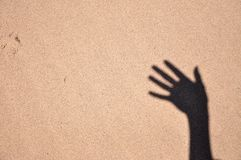 Hand on the sand Royalty Free Stock Photo