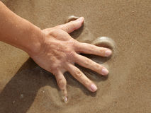 Hand on sand. Stock Images