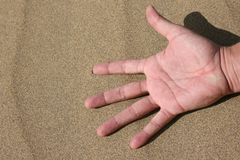 Hand in the Sand Royalty Free Stock Photos