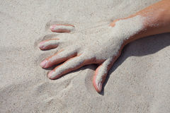 Hand and sand. Stock Photography
