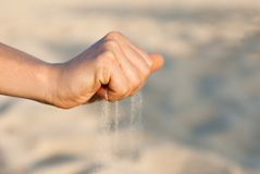 Hand with sand. Single woman hand with sand Stock Photo