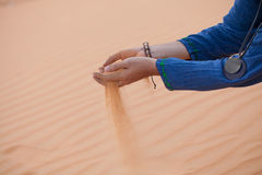 Hand with sand Stock Image