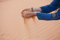 Hand with sand Stock Images