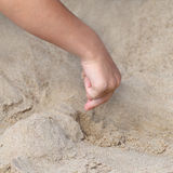 Hand with sand Royalty Free Stock Photo