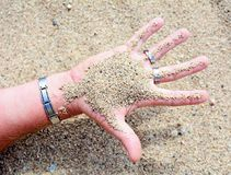 Hand with sand Royalty Free Stock Image