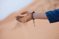 Hand with sand Royalty Free Stock Images