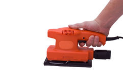 Hand and sander. An isolated over white caucasian human hand holding an orange electric sander royalty free stock photos