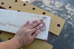 Hand sanding Stock Photography