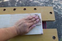 Hand sanding. Sanding and preparing wood for making furniture Stock Image