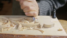 Hand sanding wooden decorative items, decorative elements, stock video