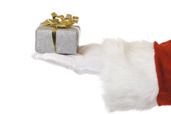 Hand of Santa Claus holding Christmas present Royalty Free Stock Image