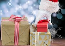 Hand of santa claus picking up christmas gifts Stock Images