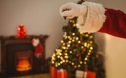 Hand of santa holding car key Stock Photo