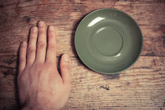Hand and saucer Royalty Free Stock Image