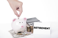 Hand saving money in piggy bank for message retirement. stock photography