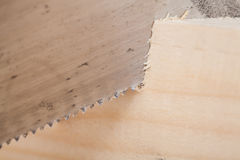 Hand saw cutting through a beam of wood Royalty Free Stock Photo