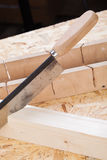 Hand saw cutting through a beam of wood Royalty Free Stock Image