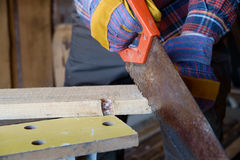 Hand saw cutting boards Stock Images