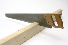 Hand saw cutting wood Stock Photo