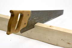 Hand saw cutting wood Stock Image