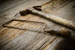 Hand Saw and Hammer on Rustic Wood Royalty Free Stock Photo