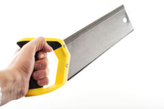 Hand with saw Royalty Free Stock Photos