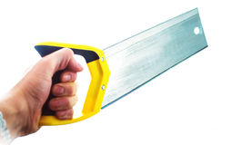 Hand with saw Stock Image