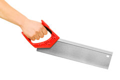Hand with saw. Stock Image