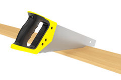 Hand Saw Tool and Wood Board Royalty Free Stock Photography