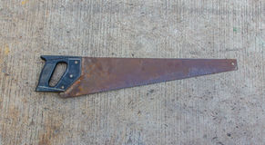 Hand saw wood Stock Images