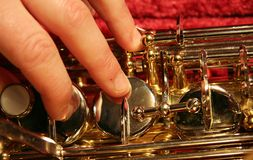 Hand on saxophone Royalty Free Stock Photography