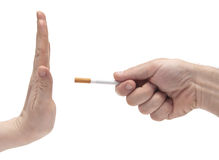 Hand saying no thanks to proposed cigarette Stock Images