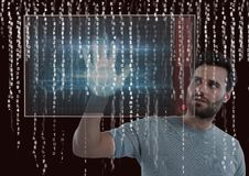 Hand scan on a screen and rain of binary code Stock Photos