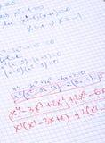 Hand schriftliche Matheberechnungen Stockfotografie