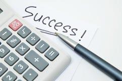 Hand schriftliches Erfolgswort auf Papier Stockbild