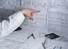 Hand of the scientist. Near the plan stock photography