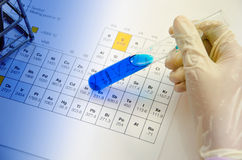 Hand scientist hold test tubes medical glassware on periodic tab Royalty Free Stock Photo
