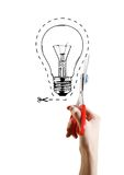 Hand scissor lightbulb Stock Photos