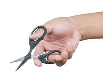 Hand with scissors. Male hand holding a pair of sharp scissors isolated on a white background Stock Images