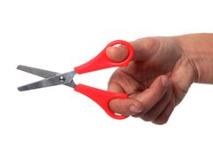 Hand and Scissors Royalty Free Stock Photography