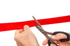 Hand with scissors cutting red ribbon - opening ceremony Royalty Free Stock Photography
