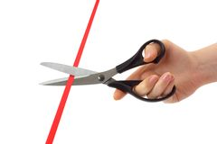 Hand with scissors and ribbon Royalty Free Stock Photo