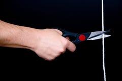 Hand & scissors & rope Stock Image